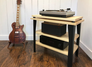 Maple stereo and turntable console with album storage.