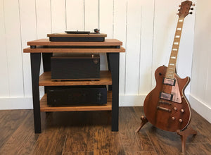 Mahogany stereo and turntable console with optional album storage.