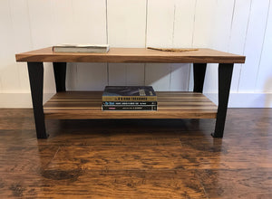 Contemporary walnut coffee table with steel legs.