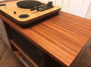 Solid mahogany turntable and stereo console with album storage.