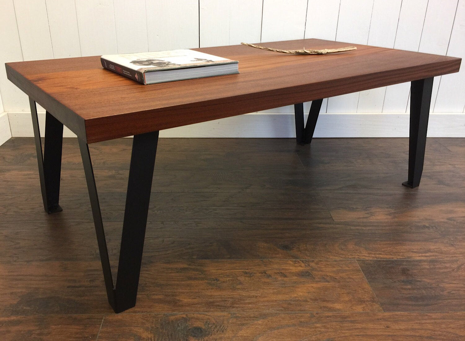 Contemporary industrial coffee table, solid mahogany with steel legs.