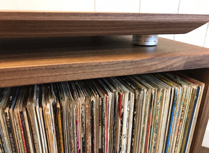 Solid walnut turntable and stereo console with isolation platform and album storage.
