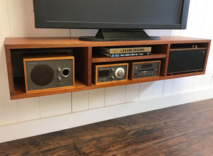 Solid mahogany floating TV and video console. Wall mounted media cabinet.