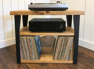 Compact stereo and turntable console with album storage, solid butternut with steel legs.