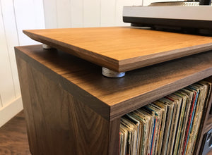 Solid walnut and white oak turntable/stereo console with isolation platform and album storage.