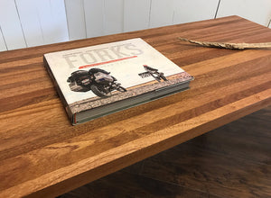 Contemporary wood and steel coffee table, solid mahogany with industrial metal legs