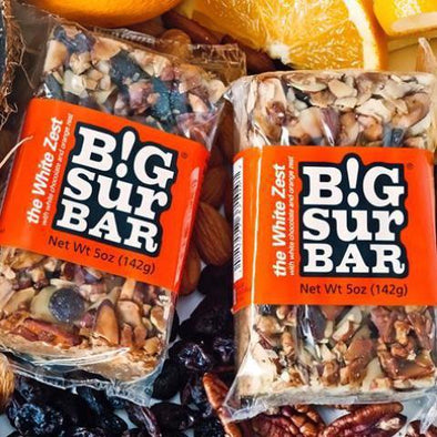 The White Zest Big Sur Bar, orange label, almonds, pecans, raisins, coconut, white chocolate, orange zest, honey, oatmeal. All Natural. No additives or preservatives.