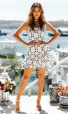 On The Dotted Line White Black Polka Dot Pattern Sleeveless Bow Square Neck Low Back Ruffle Casual Mini Dress- Sold Out