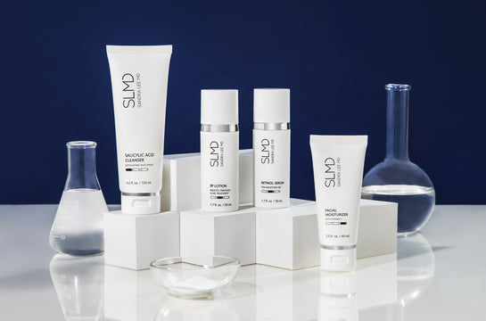A photograph of the 30 day kit SLMD Acne System: Salicylic Acid Cleanser, BP Lotion, Retinol Serum, Facial Moisturizer