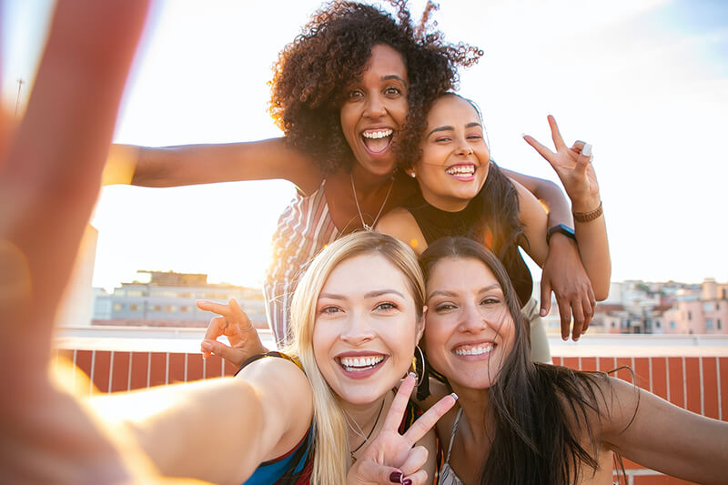 A selfie of young women who have time to prevent the signs of premature aging with retinol