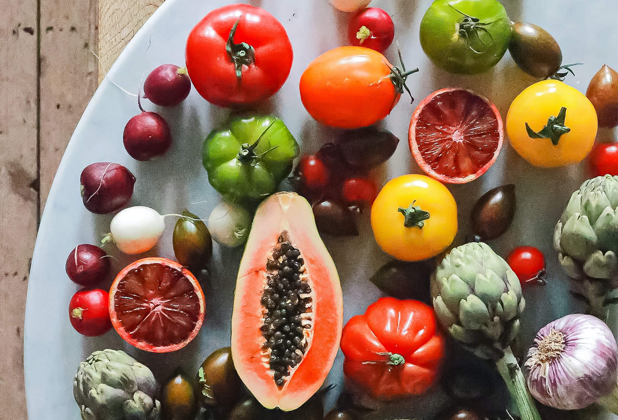 Free radical fighting fruits and vegetables with antioxidants found in Bright Future Vitamin C Serum by SLMD Skincare