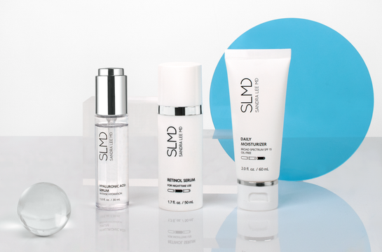 A photograph of SLMD Plump, Prevent, Protect System: Hyaluronic Acid Serum, Retinol Serum, Daily Moisturizer with SPF 15