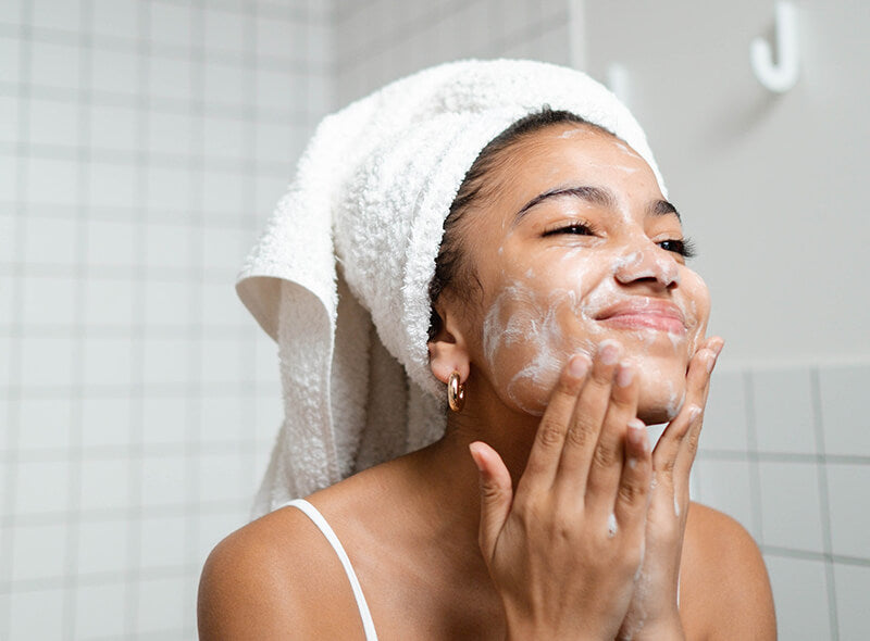A woman experiencing the benefits of double cleansing