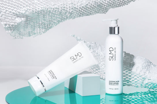A photograph of SLMD Body Smoothing System to treat keratosis pilaris: Glycolic Acid Body Lotion, Glycolic Acid Body Scrub, with refracted light