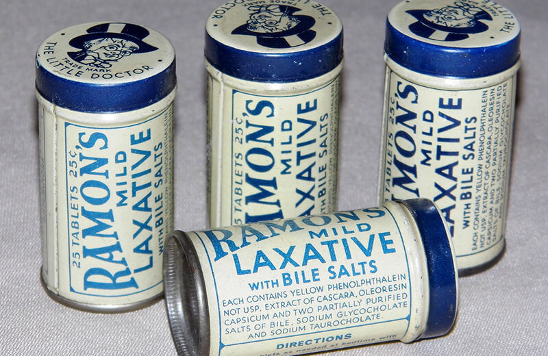 Vintage laxative tins from 1930s history of acne remedies by SLMD Skincare