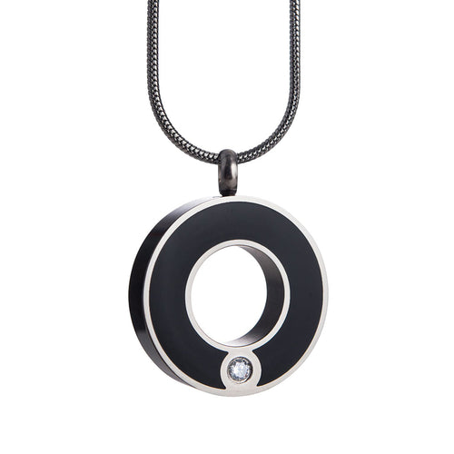 Circle of Life cremation necklace. An epoxy black circle and swarovski crystal.