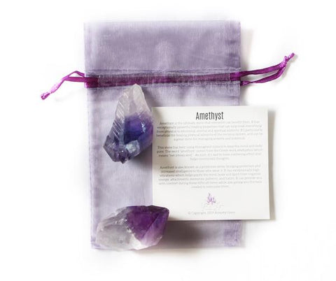 amethyst crystals with a piece of paper describing the crystal