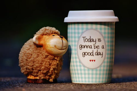"coffee cup with the quote saying ""today is going to be a good day"""