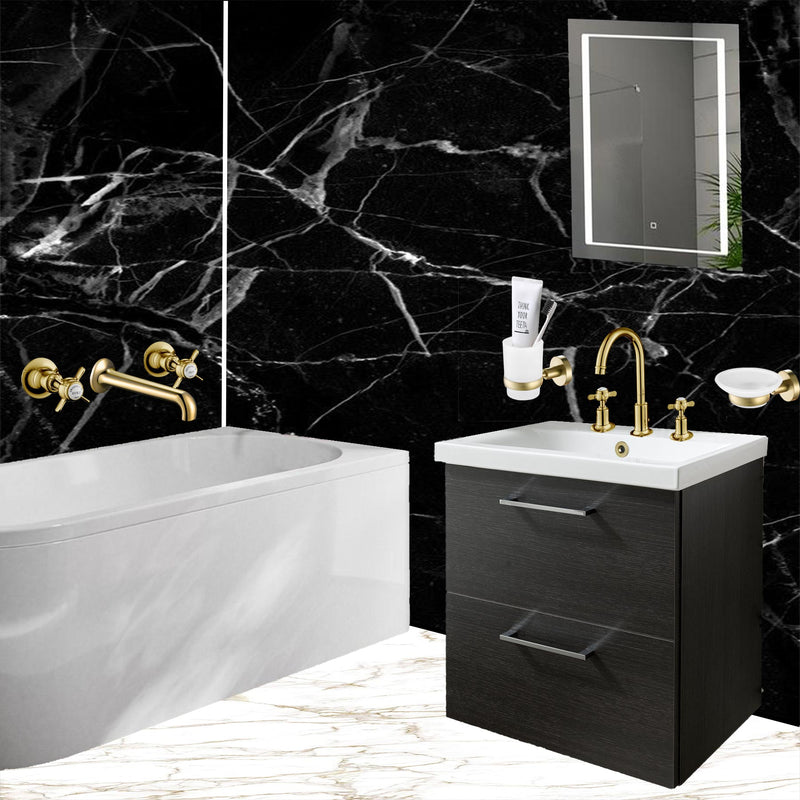 Gold 3 hole basin mixer with matching gold soap dish and tumble and gold bath filler installed in a trending bathroom.