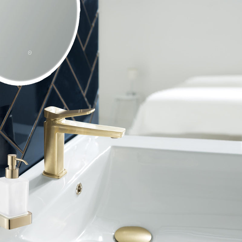 Gold HIX basin mixer with matching gold soap dispenser and gold matching basin waste.