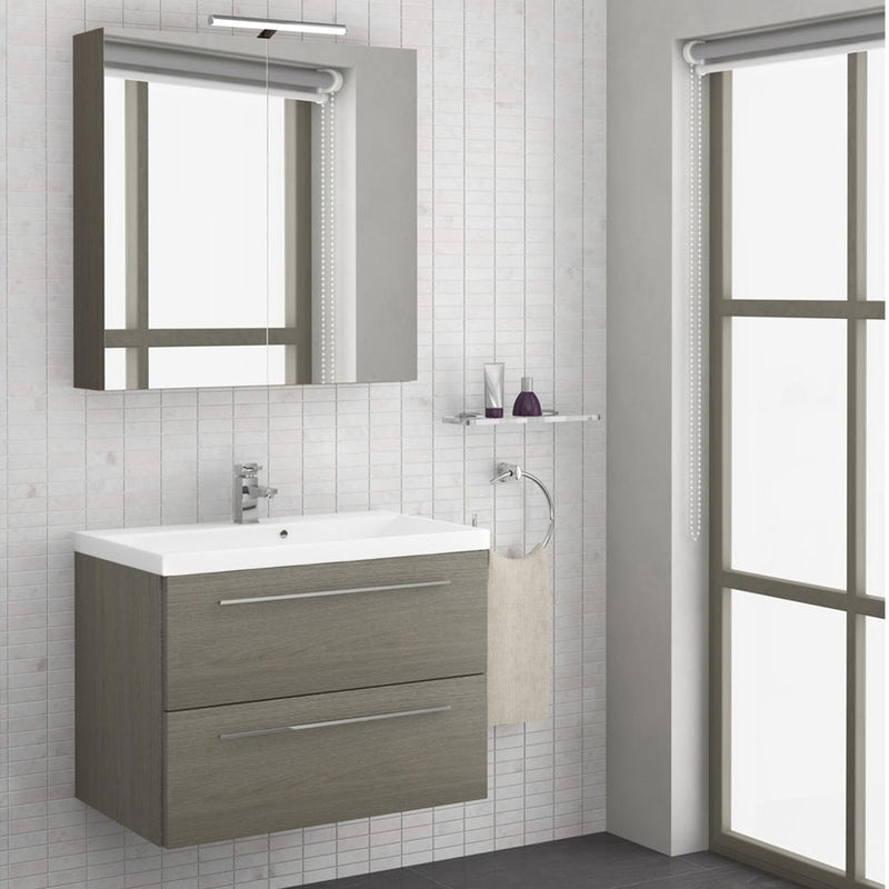 Grey wall mounted vanity unit with basin and 2 drawers on a bathroom wall with a bathroom mirror above it and bathroom toiletries on the side of the vanity unit