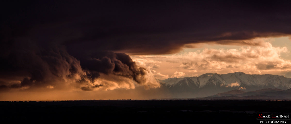 The Arrival - A storm cloud over the Canterbury Plains