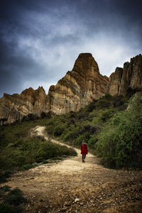 Fine-Art-Girl-Red-Jacket-Walking-Moody-Clay-Cliffs-Omarama-Mark-Hannah-Photography