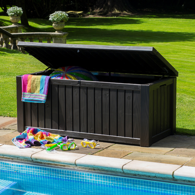Keter Rockwood Storage Box by the pool with lid open showing handy storage