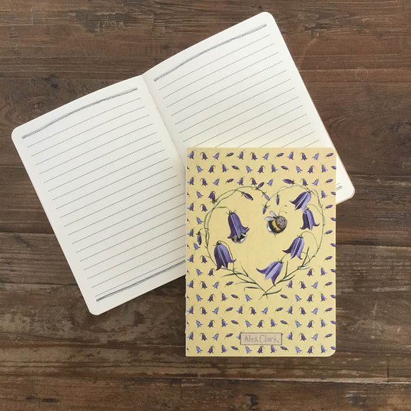 This 100-page notebook is decorated with a beautiful illustration by Alex Clark showing two bumble bees surrounded by a heart of bluebells. This notebook makes a feature of the classic stitched binding with an exposed spine.