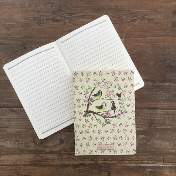 This 100-page notebook is decorated with a beautiful illustration by Alex Clark showing four garden birds perched on a tree blossoming with pink flowers  This notebook makes a feature of the classic stitched binding with an exposed spine.