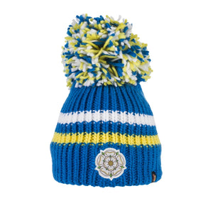 This Yorkshire themed bobble hat is knitted in a bright blue acrylic wool with two horizontal stripes - one white and one yellow. A Yorkshire Rose emblem has been sewn to the front and the hat is topped with a magnificent blue, white and yellow bobble.  These hats stretch and so are suitable for adults and children over the age of 5.