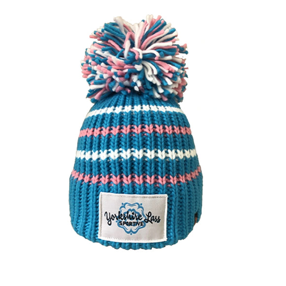 This Yorkshire themed bobble hat is knitted in a mid-blue acrylic wool with alternating light pink and white horizontal stripes. A Yorkshire Lass Sportive emblem has been sewn to the front and the hat is topped with a magnificent blue, white and pink bobble.  These hats stretch and so are suitable for adults and children over the age of 5.