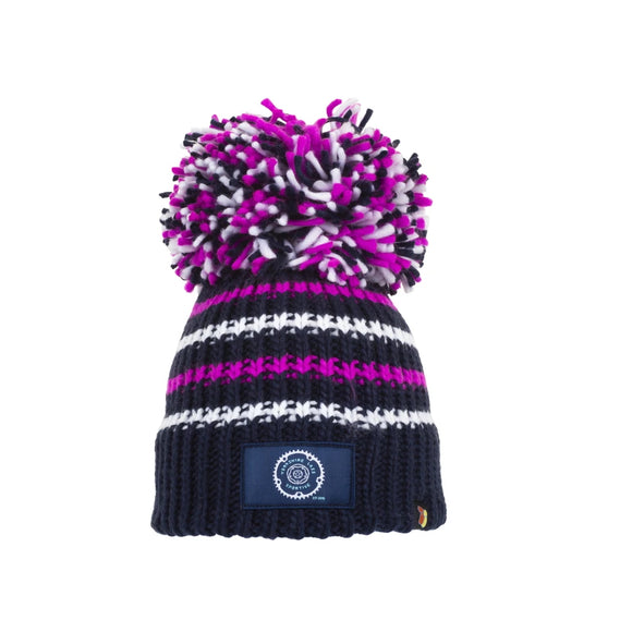 This Yorkshire themed bobble hat is knitted in a dark navy blue acrylic wool with alternating bright pink and white horizontal stripes. A Yorkshire Lass Sportive emblem  has been sewn to the front and the hat is topped with a magnificent blue, white and pink bobble.  These hats stretch and so are suitable for adults and children over the age of 5.