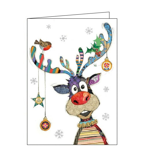 Beautiful, quirky and dramatic. This Christmas card from Bugart features brightly coloured illustration of a patchwork Rudolf - complete with red nose - and Christmas baubles hanging from his antlers.  Somewhere on the card is a tiny bug. Can you spot it?Beautiful, quirky and dramatic. This Christmas card from Bugart features brightly coloured illustration of a patchwork Rudolf - complete with red nose - and Christmas baubles hanging from his antlers.  Somewhere on the card is a tiny bug. Can you spot it?