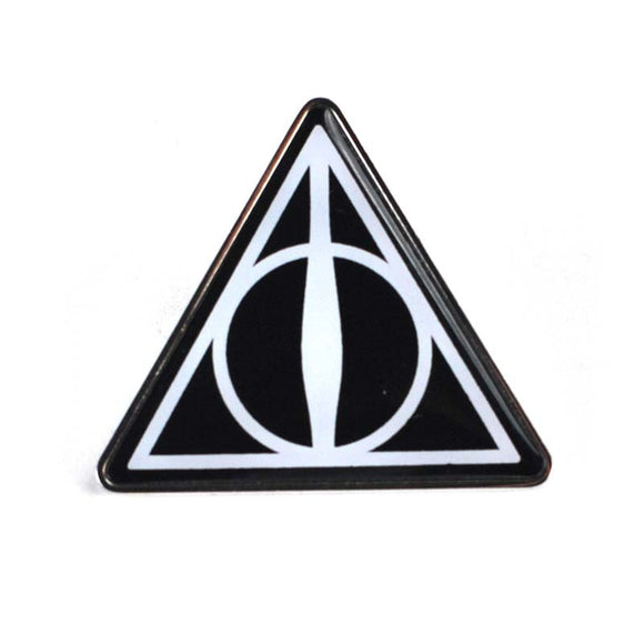 This enamel pin badge has a black background and is decorated with the symbol for the Deathly Hallows comprised of a triangle for the cloak of invisibility, a circle for the resurrection stone, and a line for the elder wand.