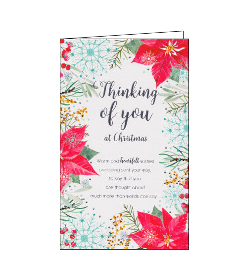Red poinsettia flowers, berries and blue snowflakes decorate the front of this Christmas card. Silver text on the front of the card reads