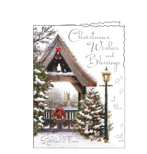 This Jonny Javelin Christmas card is decorated with a scene of a lych gate with Christmas trees on either side and a wreath on the gate. Silver text on the front of this Christmas card reads