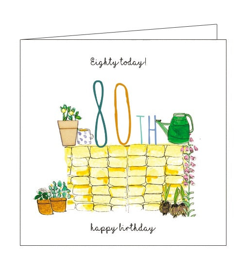This 80th birthday card is decorated with an illustration of a garden wall composed of yellow brick . A cup of tea, an embellished plant pot, a watering can and a large