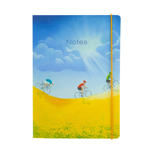 Perfect for planning out next year's cycling training, this A5 lined notebook from Tour de Yorkshire artist Lucy Pittaway's illustration of three cyclists riding past a field of yellow flowers, under a beautiful blue sky. Text on the front of the notebook reads