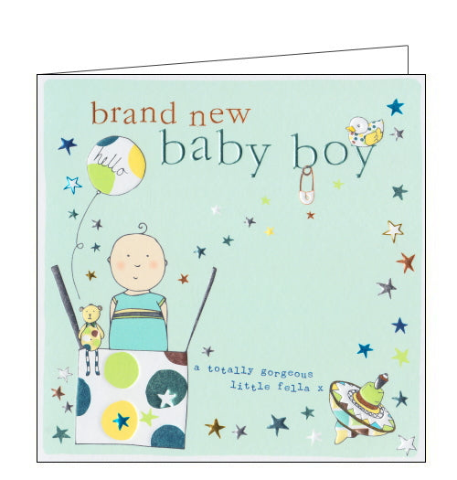 This lovely little new baby card is decorated with an illustration of a baby boy - popping out of a box, along with balloons and stars. The text on the front of the card reads