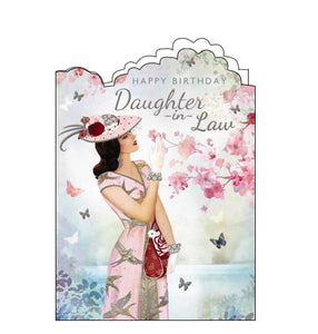 "A stunning birthday card for an elegant Daughter in Law. An artwork by Claire Coxon on the shows a woman in a pink dress and hat reaching up to look at pink blossoms on a tree. Silver text on the front of the card reads ""Happy Birthday Daughter-in-Law""."