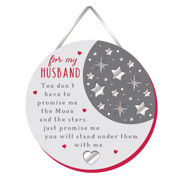 Spoil your husband a little with this little sentimental plaque. This round wooden plaque is decorated with tiny silver stars and text that reads