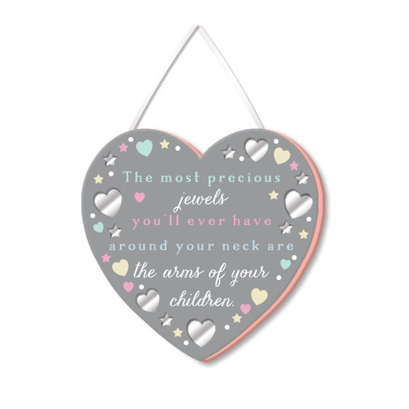 This sweet heart shaped plaque is perfect for mother's day. Pastel coloured text on the plaque reads