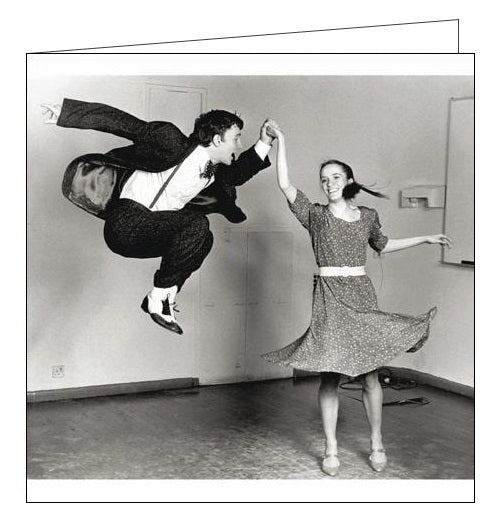 This blank card from Woodmansterne's Framed range features a black and white photograph of a man and woman dancing. The man is in a suit, suspenders and bowtie and is mid jump.
