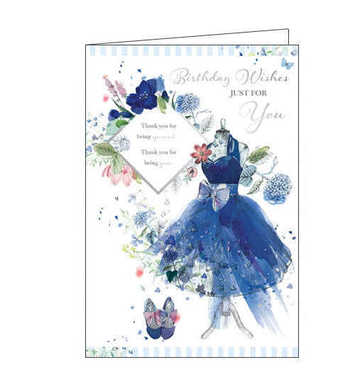 An elegant blue party dress with a big silver bow and matching high heels decorates the front of this birthday card. The text on the front of the card reads