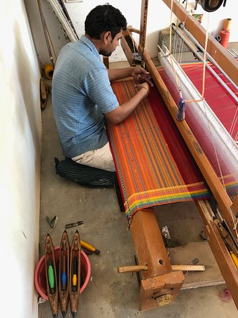 Handweaving on wooden handloom india