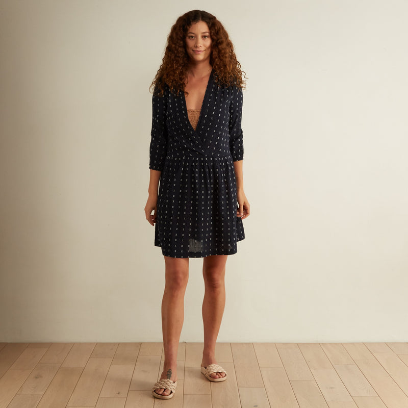 The Odells Voyage Breezy Deep V Neck Dress