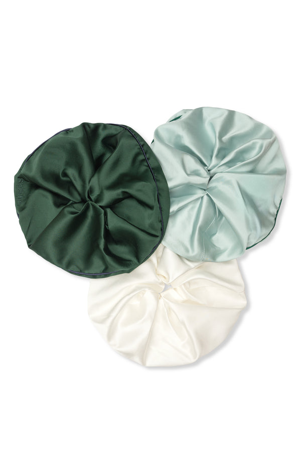 Set of three Shayne jumbo silk scrunchies in olive green, light blue, and white.