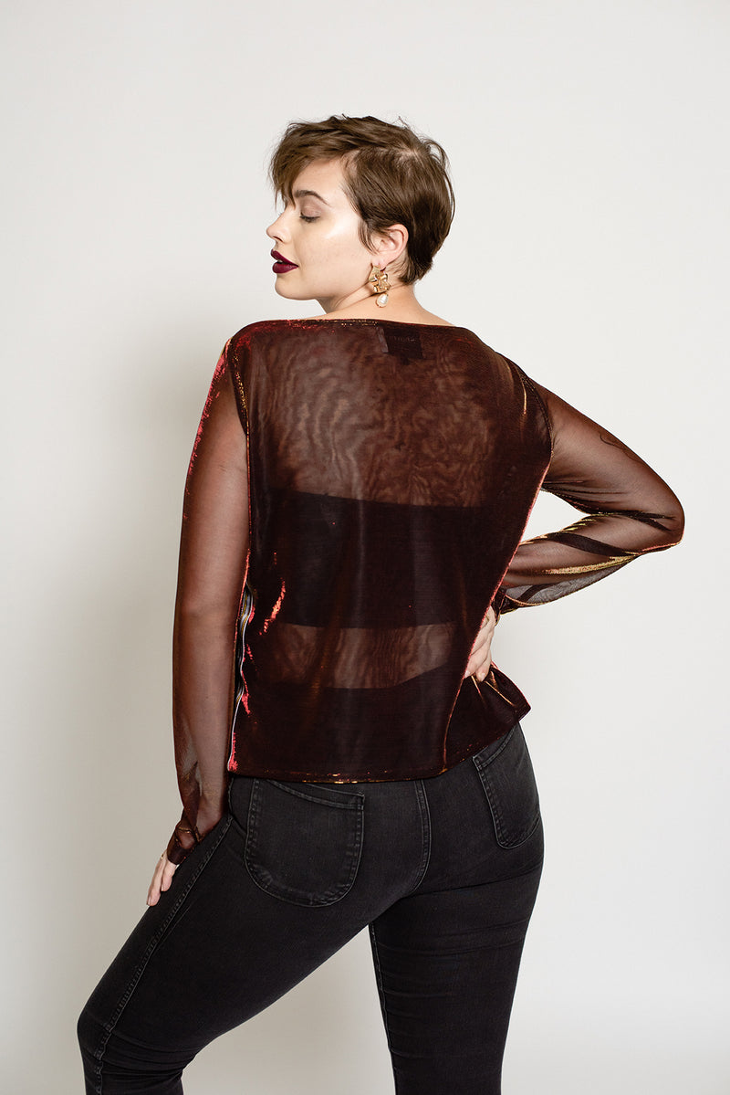 Sheer three tone metallic top is a festive piece for your holiday outfit