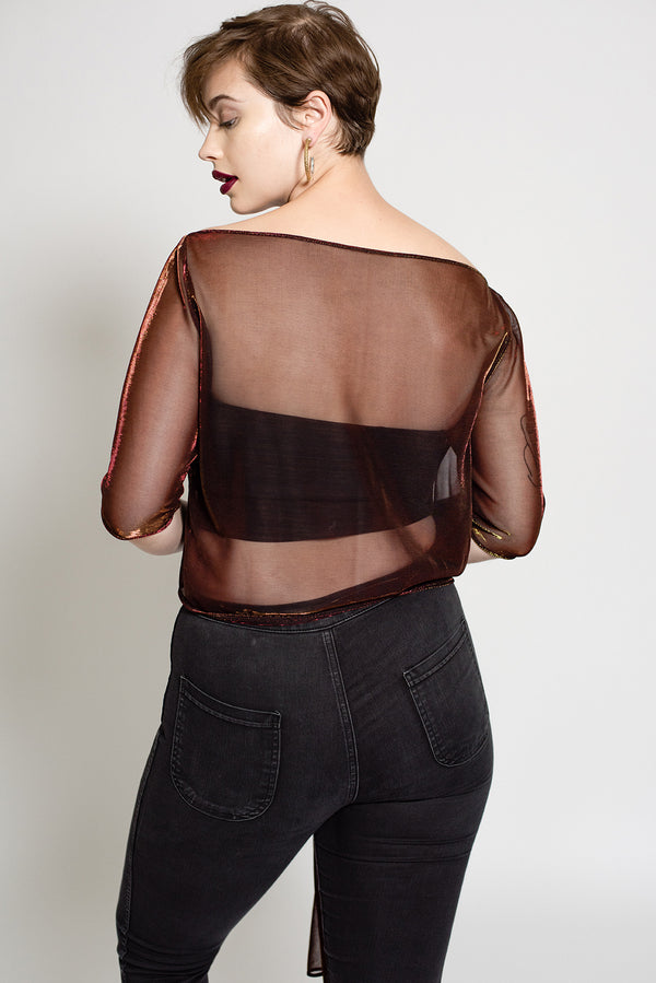Plus size sheer metallic top with boat neck